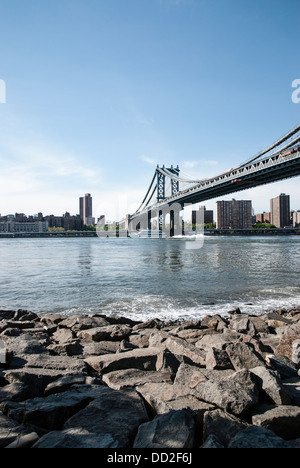 Manhattan bridge, New-York USA, under a clear blue sky. Captures from Brooklyn side in May 2013. In background, - Stock Photo