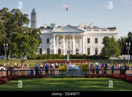 Crowds on Pennsylvania Avenue Washington DC in front of the White House - Stock Photo
