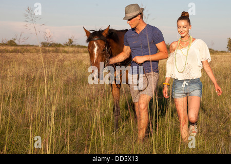 Croatia, Dalmatia, Young couple with horse in a meadow - Stock Photo
