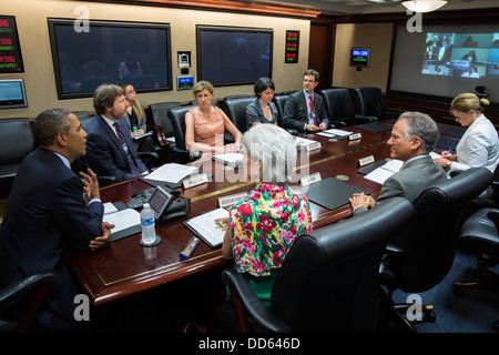 President Barack Obama participates in an Affordable Care Act videoconference in the Situation Room of the White - Stock Photo
