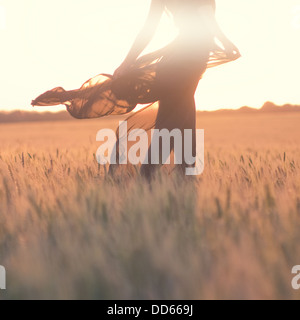 silhouette of woman body in the field - Stock Photo