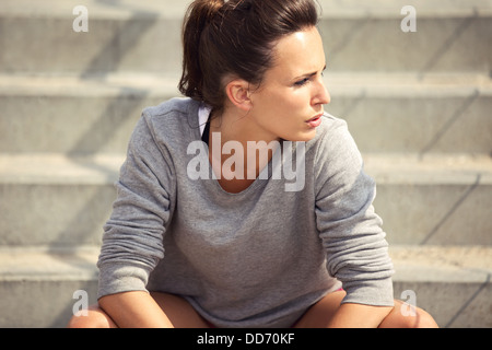 Closeup of an attractive female athlete resting after workout - Stock Photo