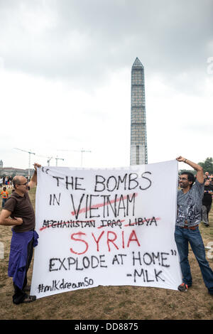 Protestors hold a large banner campaigning against possible military action against Syria on Washington DC's National - Stock Photo