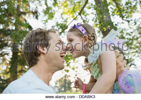 Portrait of father and daughter outdoors - Stock Photo