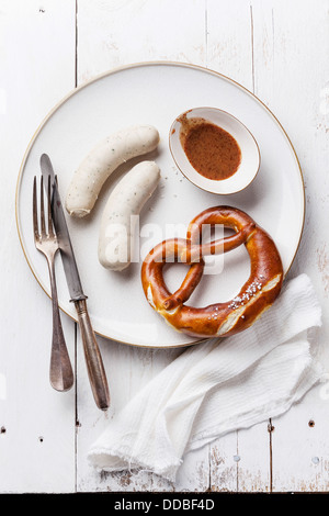 Bavarian snack with weisswurst white sausages - Stock Photo