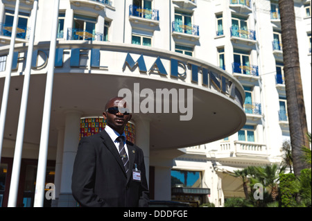 Europe, France, Alpes-Maritimes, Cannes Film Festival, a security guard at the Hotel Martinez during the film festival. - Stock Photo