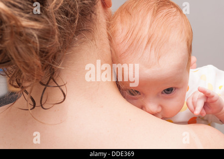 Mother from Behind Holding Newborn Baby - Stock Photo