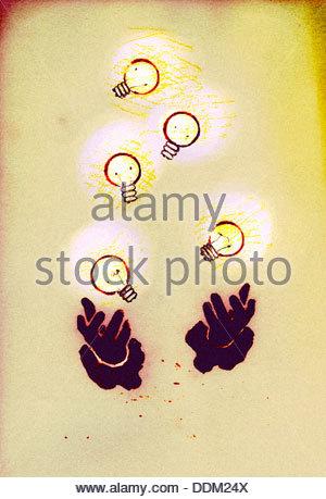 Hands juggling illuminated light bulbs - Stockfoto