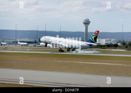 South African Airways Airbus A340-300 landing at Perth Airport, Western Australia - Stock Photo