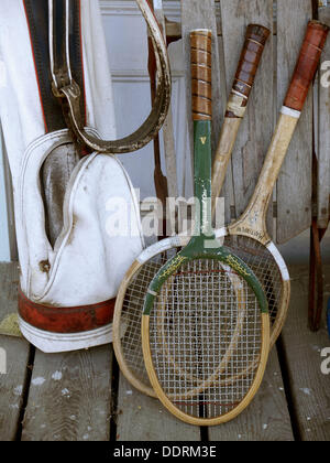Tennis golf. Old clubs and rackets at an old country store. - Stock Photo
