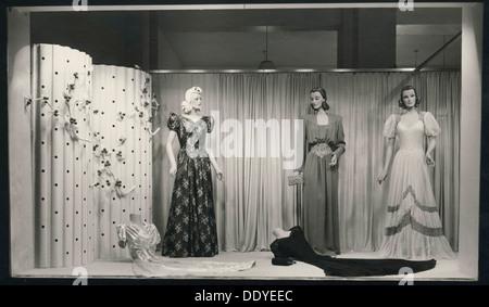 Evening dresses in a shop window, Landskrona, Sweden, 1940. - Stock Photo