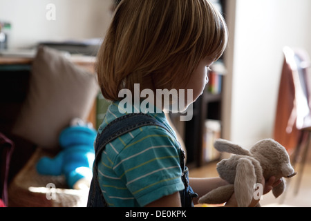 Little boy playing with stuffed toy - Stockfoto