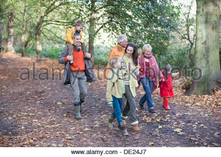Extended family walking outdoors in autumn - Stock Photo