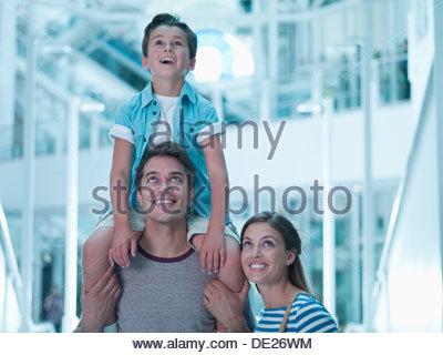 Smiling family in shopping mall - Stock Photo