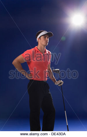 Golf player holding club - Stock Photo