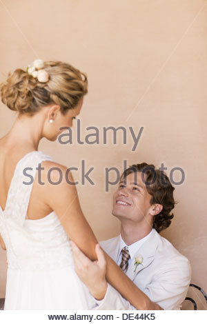 Bride and groom hugging - Stock Photo