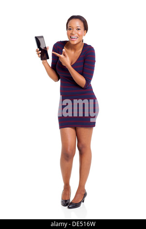 pretty African woman pointing at tablet computer on white background - Stock Photo