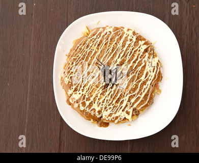 Pizza Japanese style on plate - Stock Photo