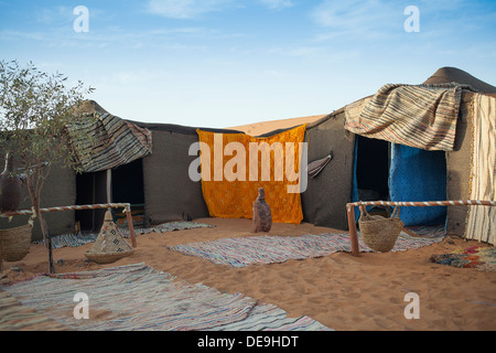 Berber tent camp in the Moroccan sahara at sunset - Stockfoto