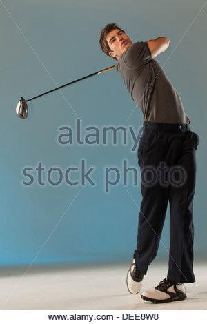 golf player swinging club - Stock Photo