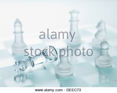Close up of glass chess pieces - Stock Photo