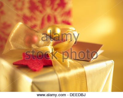 Christmas gifts with gold ribbons - Stock Photo
