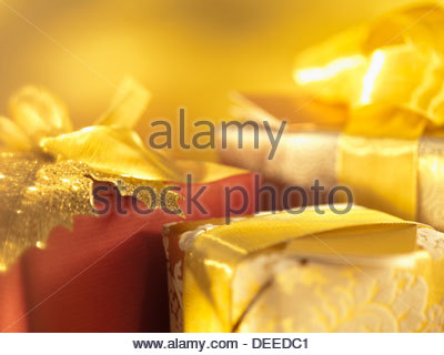 Christmas gifts with gold ribbon - Stock Photo