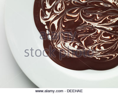 Bowl of melted chocolate - Stock Photo