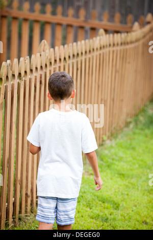 boy walking away - Stock Photo