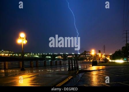 Lightning strike over the Mississippi river and bridges, downtown. Saint Paul, Minnesota - Stock Photo