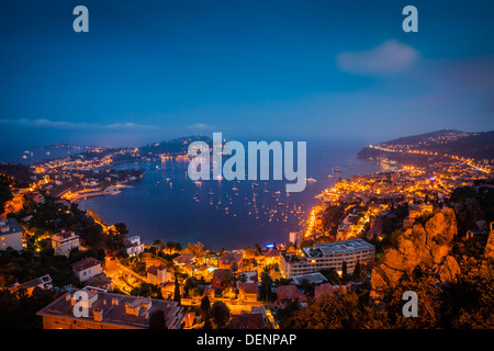 Twilight view over Villefranche-Sur-Mer, along the Cotes d'Azur, Provence France - Stock Photo
