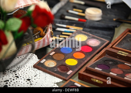 Make-up artist's bag with a variety of make-up brushes and colours  - Stock Photo