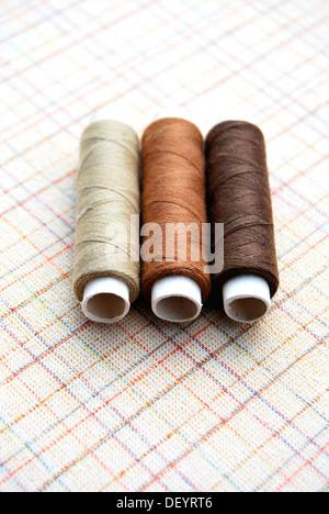 Yarn, cotton reels, spools of thread, brown, beige - Stock Photo