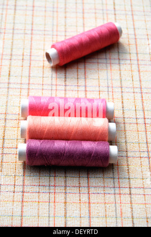 Yarn, cotton reels, spools of thread, pink, purple - Stock Photo