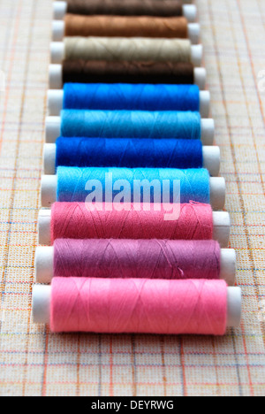 Yarn, cotton reels, spools of thread, colourful - Stock Photo