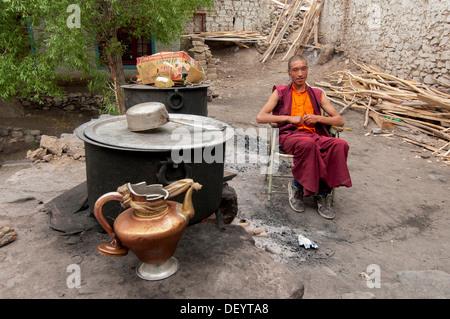 India, Jammu & Kashmir, Ladakh, a monk listening to music through ear buds at Hemis Monastery - Stock Photo
