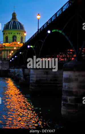 The Pont des Arts at dusk, with a view to the Institut de France, Paris, Ile-de-France, France - Stock Photo