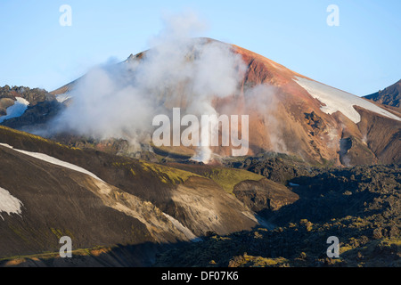 View from the Bláhnúkur volcano to the Brennisteinsalda volcano and the Laugahraun lava field, rhyolite mountains - Stock Photo