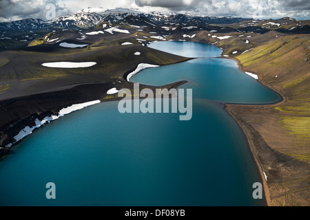 Aerial view, Lake Skyggnisvatn, moss-covered landscape and snow-covered mountains, Icelandic Highlands, Iceland, - Stock Photo