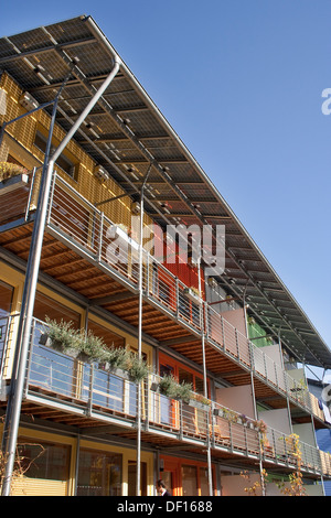 Freiburg, Germany, balcony facade of a residential building of the solar village in the Vauban quarter - Stock Photo