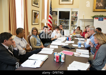 President Barack Obama meets with senior staff in Chief of Staff Denis McDonough's office in the West Wing of the - Stock Photo
