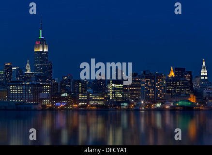 The New York City Skyline during the blue hour after sunset. The Empire State Building. - Stock Photo