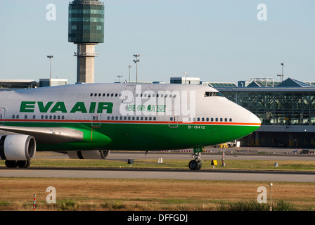 Eva Airlines Boeing 747 45E taxiing at Vancouver International Airport - Stock Photo