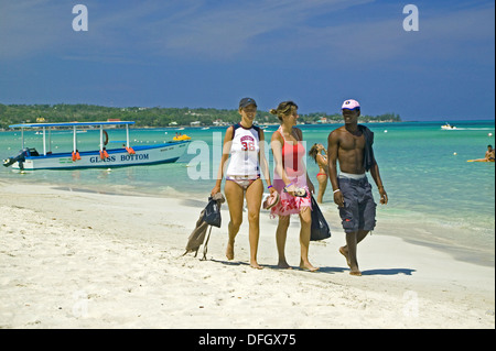Strolling on Negril beach, Jamaica - Stock Photo