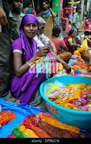 A week before Rakhi festival. Full of people selling and buying colorful Rakhi on the street in Old Delhi - Stock Photo