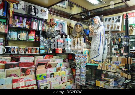 Souvenir shop near Mother Teresa's Mother House, Calcutta, India - Stock Photo