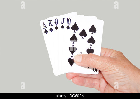 Isolated hand held royal flush of spades - Stock Photo