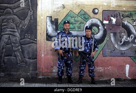 Gaza City, Gaza Strip, Palestinian Territory, . 19th Oct, 2013. Palestinian police men stand guard during a press - Stock Photo