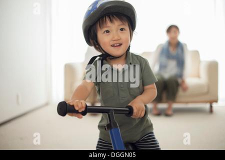 Boy wearing cycling helmet, portrait - Stock Photo