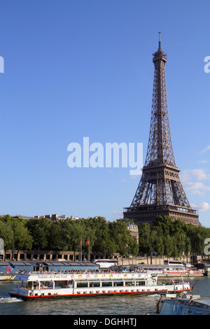 Paris France Europe French Seine River Eiffel Tower Bateau Mouche cruise boat Left Bank view - Stock Photo
